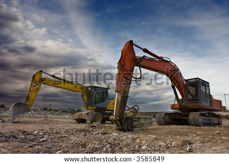 Two bulldozers parked in a blowned building