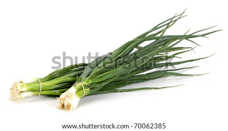 two bunches of spring onions on a white background