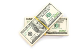 two bundles of one hundred dollar bills tied with an elastic band, isolated on a white background.View from above. Copy space.