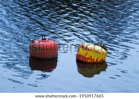 Two buoys floating in the River Dee, Chester on a late spring evening Сток-фото ©