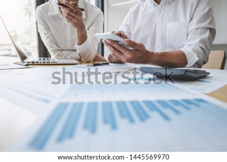 Two business colleague meeting to brainstorm the new project business strategy plan and analysis data document, finance and accounting concept Briefing, brainstorming, consulting. #1445569970