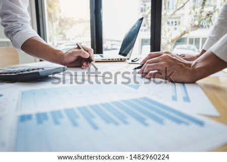 Two business colleague meeting to brainstorm the new project business strategy plan and analysis data document, finance and accounting concept Briefing, brainstorming, consulting. #1482960224