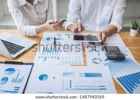Two business colleague meeting to brainstorm the new project business strategy plan and analysis data document, finance and accounting concept Briefing, brainstorming, consulting.