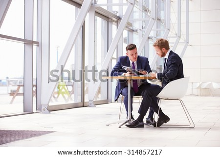 Two business colleagues at meeting in modern office interior Stockfoto ©