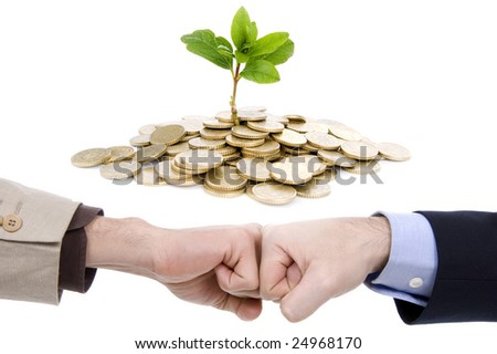 Two business fists and plant in coins, isolated on white background