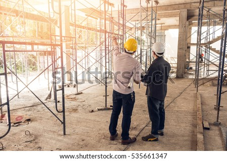 two business man construction site engineer, effect sun flare
