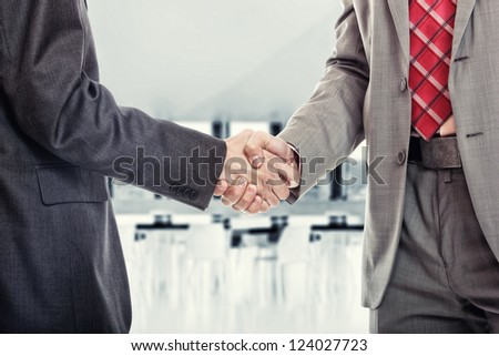 Two business man handshake at the office building