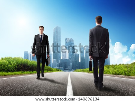 two business men on the road