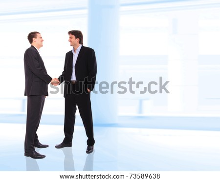 two business men shaking hands at corporate