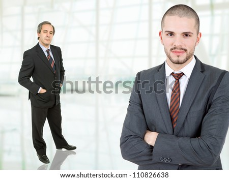 two business men standing at the office