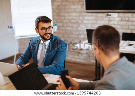 Two business men talking in the office