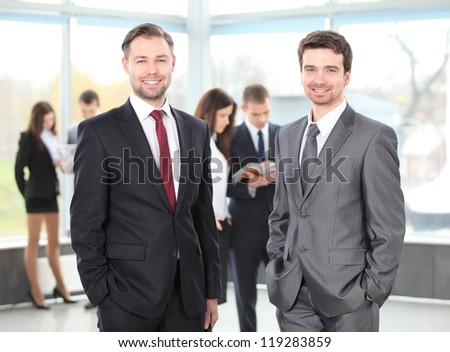 Two business men working together in the office