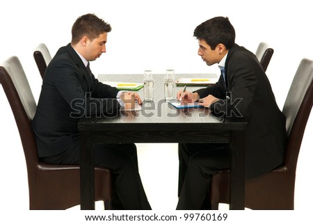Two business men writing and discuss in office