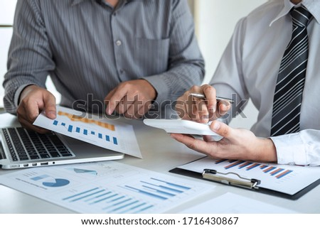 Two business partner team meeting and discussion financial project of investment ideas, presentation and analyzing marketing planning strategy of business making to growth profit and successful.