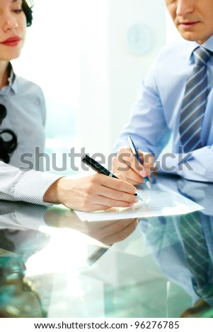 Two business partners signing an agreement