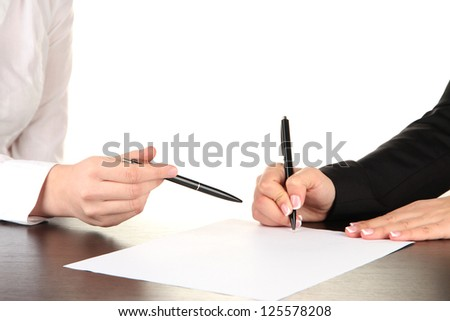 Two business partners signing document, isolated on white