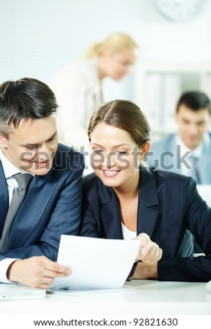 Two business partners sitting in office and discussing plan