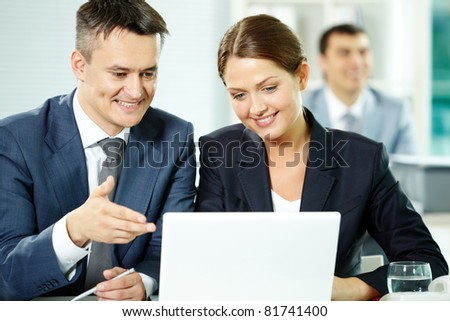 Two business partners sitting in office and planning work