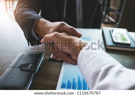 two business partnership handshake after discussing agreement deal investment trading #1110670787