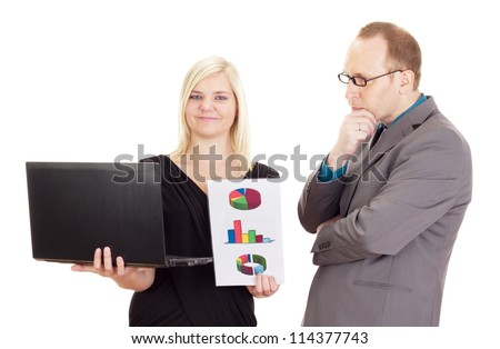 Two business people analysing some facts