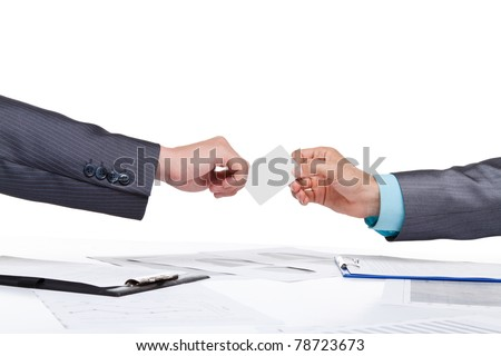 Two business people hands in elegant suits sitting at desk and give blank empty card, working in team together with documents sign up contract. Isolated over white background.