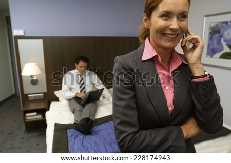Two business people in hotel room