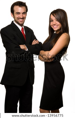Two business people man wearing black business suit woman in black formal dress with arms crossed and friendly smiles over white