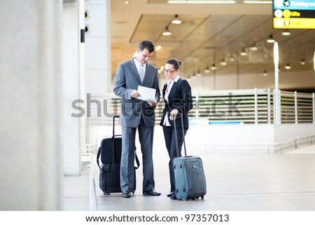 two business people meeting at airport