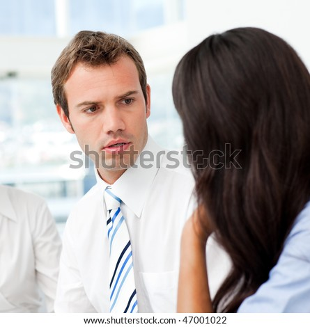 Two business people talking together in the office