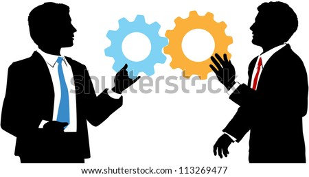 Two business people work together to connect gear symbols of tech solution deal