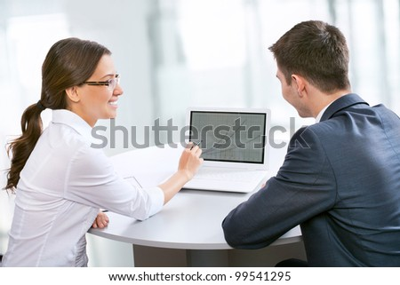 Two business people working in the office - stock photo
