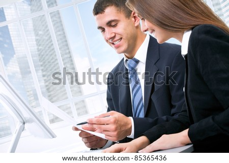 Two business people working together at office