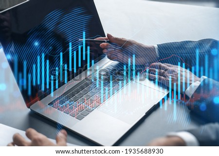 Two business people working together on stock market strategy. Try to analyze forex behavior. Financial graph hologram. Double exposure.