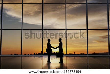 Two Business shake hand silhouettes rendered with computer graphic.