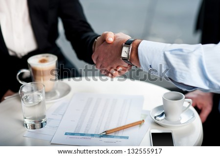 Two business tycoons meet over a coffee and closed long-term deal. #132555917
