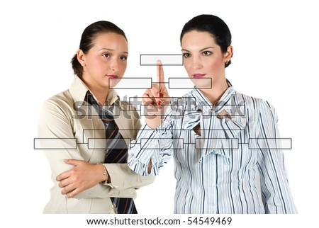 Two business woman  with a blank diagram buttons discussing and one of them pointing on last button