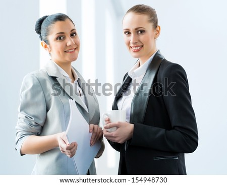 two business women discussing documents in the office