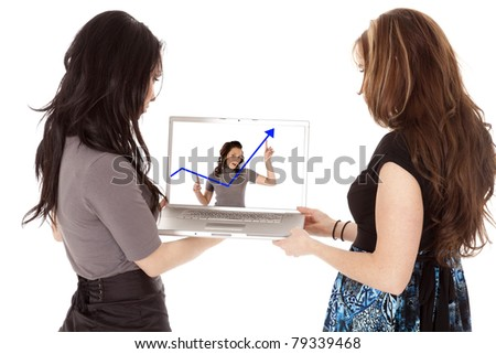 Two business women looking at the screen of their laptop.  Looking at a woman with a blue arrow graph.