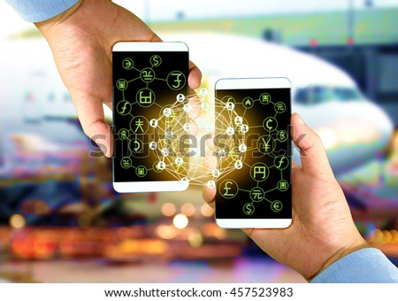 Two Businessman hands holding smartphones , Fintech concept and Peer-to-peer icon , world currency with airplane coded abstract background #457523983