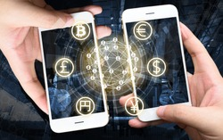 Two Businessman hands holding smartphones. Fintech concept , Peer-to-peer concept with map and world connect , hi-tech building abstract background