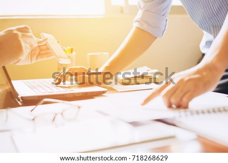 Two businessman investment consultant analyzing company financial report balance sheet statement working with documents graphs. Concept picture for stock market, office, tax,and project. #718268629