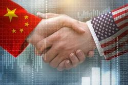 two businessman shake hands, China–United States trade war