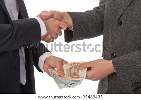Two businessmen and paying money; isolated on white