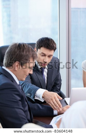 Two businessmen are discussing in the office