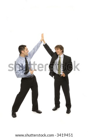 Two businessmen give each other a high five