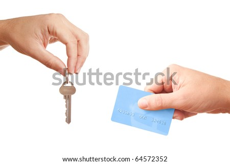 Two businessmen hands passing each other modern key and plastic bank credit card while selling/buying or letting/renting real estate, isolated on white background