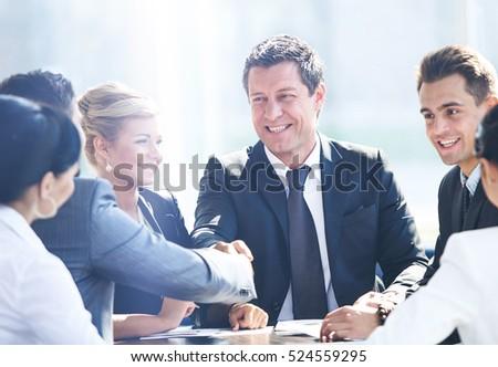 Two businessmen handshaking after striking grand deal #524559295