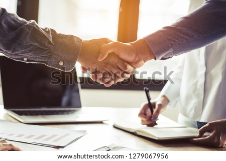 Two businessmen handshaking in meeting after final project agreement deal done. #1279067956