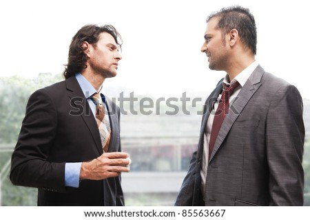 two businessmen having a casual discussion