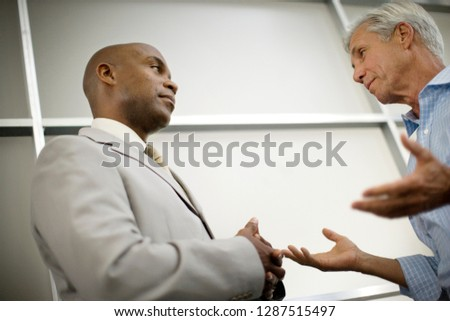 Two businessmen having a discussion. #1287515497